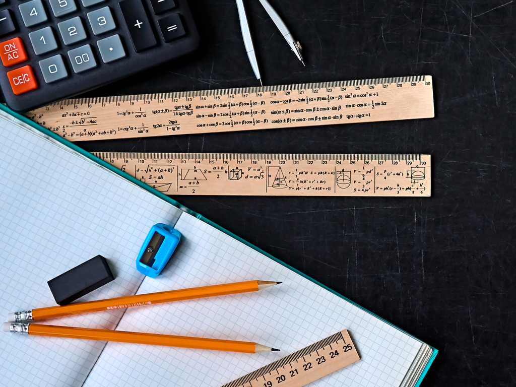 rulers pencils calculator and a workbook