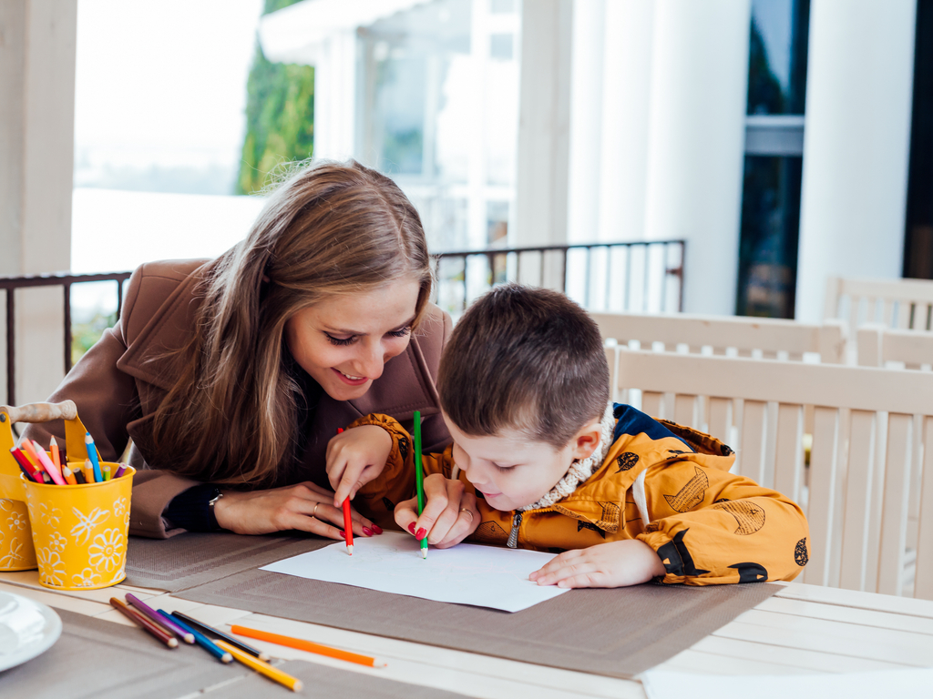 mother drawing with her young son