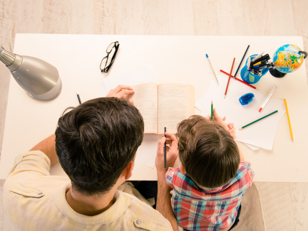 father helps son with homework