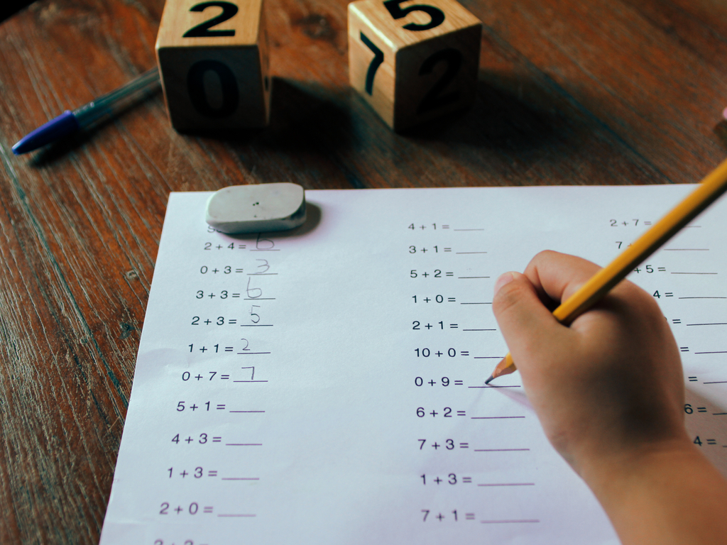 student doing first grade math homework