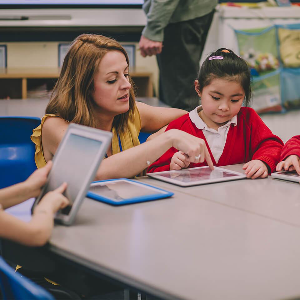 Teacher guiding student through Mathletics